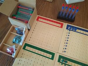 Coloured counting beads in tubes with wooden counting boards