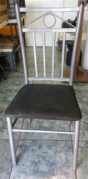 Kitchen Chairs  Grey in colour . Set of 4 Chairs .  In prestine condition .