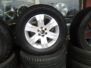 17 inch Navara/pathfinder rim with used tyre