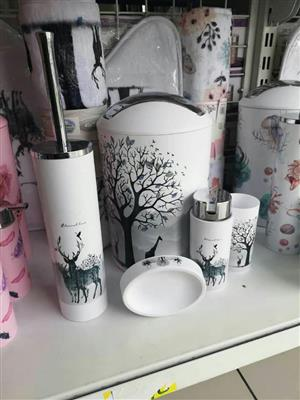 Animal and tree decorated containers and bins