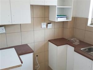 Secured open plan lounge, kitchen and bathroom, built in cupboards and stove, close to all amnesties and main roads. WhatsApp