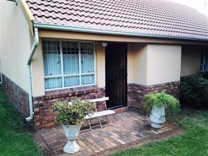 Lovely secure 2 bedr town house in security estate, Loisvilla, Erasmuskloof, Pta East. Lock up garage, plus extra parking bay, garden, small pets, close to freeway and walk to Shop-centre.