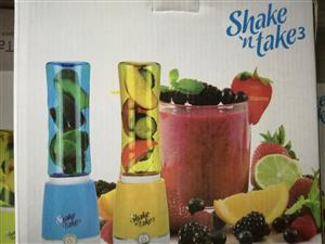 Shake 'n' Take; Smoothie Blender with 2 bottles. Instantly blends smoothies & protein shakes to go!