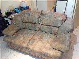 2 Seater couch for sale.