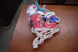 Pink and purple rollerblades for sale