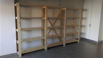 Clean up your garage, office or store with super strong wooden shelving.