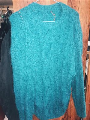 Blue wool knitted jersey for sale