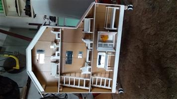 Dollhouse on wheels with furniture