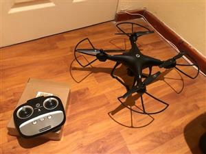 Holy Stone HS100 Drone. Flown once. Never use. Has all the features eg. GPS, follow mode, camera etc