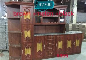 Brown,melon and black kitchen unit