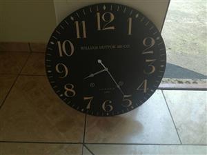 Big black William Sutton wall clock