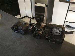 Nikon D3300 with 50 mm lens, 2 kit lenses,flashlight.