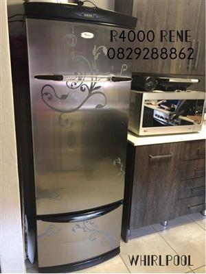 Silver Whirlpool fridge for sale