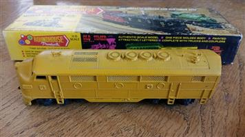 Yellow roundhouse model train