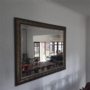 Framed, beveled mirror 400mm x 1100mm. Excellent condition.
