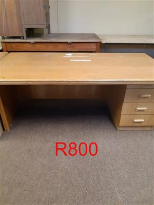 Wooden desk with drawers for sale.