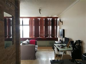 Upmarket, modern partly furnished, private corner studio apartment