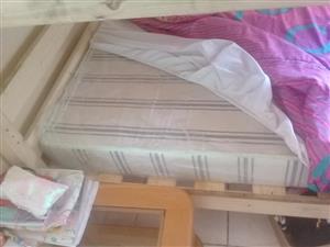 Selling bunk bed plus 2 mattresses