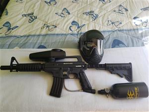 Upgraded Tippmann Bravo 1 Paintball gun with E-trigger, cyclone feeder and more.