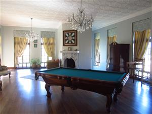 Solid carved wood, slate pool table with accessories & 4 chairs.
