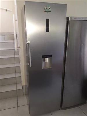 Silver fridge with water dispenser