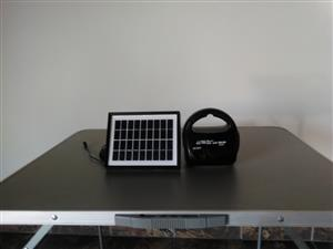 Radio, torch, lantern and panel charger