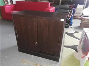 Dark wooden sliding door cabinet