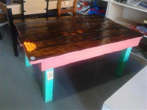 Pink and green painted pallet table