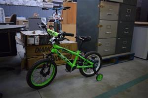 Green kiddies bike for sale