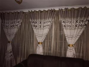 Brown and white sequence curtains