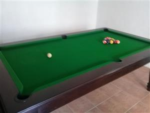 Dining room table with pool table together with table
