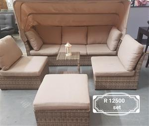 Beige patio set with pillows and awnings