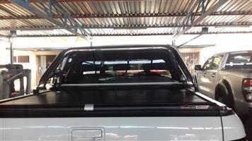 AMAROK DC BLACK SECURI LID ROLL BAR 9623