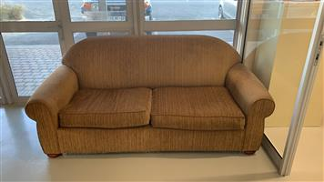 Bespoke two seater couch for sale, in great condition. brown fabric with wooden feet