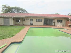 Spacious Family Home with pool, teen pad and 3 garages in Warner Beach all on dead level land.