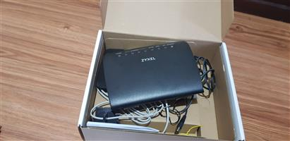 Zyxel AMG1302-T11C Fibre and ADSL router