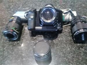 Canon T90 35 mm camera with 3 extra lenses