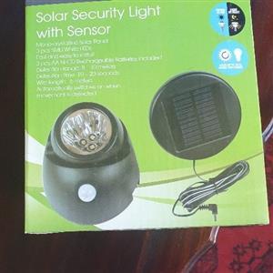 Solar security light with sensor