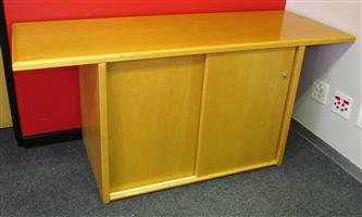MAPLE SLIDING DOOR CREDENZA WITH EXTRA LONG OVERHANGING TOP