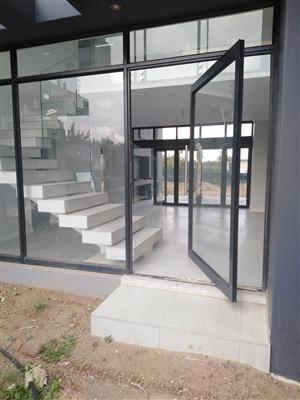 aluminium window frames, aluminium windows, aluminium garage doors, aluminium pivot door, shop fronts
