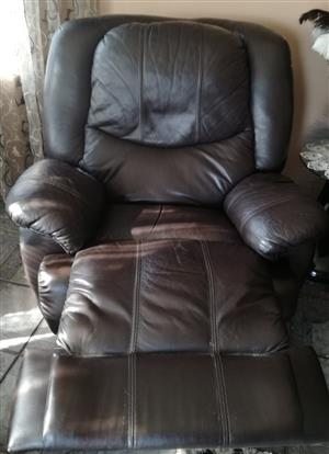 Genuine Leather Recliner. Very good condition, swivel, tilt and converts for comfortable sleep.