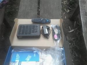 DSTV Compact decoder with all accessories, brand new dish and 25m cable.