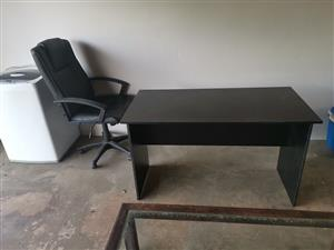 Black desk and chair with wheels
