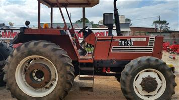 Brown Fiat 115-90 4x4 Pre-Owned Tractor