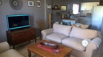 Lounge Suite - Coricraft Beige slip covers