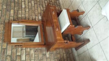 Wooden dressing table with chair. Contains 2 drawers