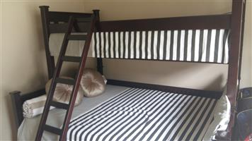 New Tribunk and 2 brand new mattresses For Sale