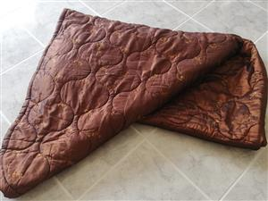 Quilted double bed comforter with 2 pillowcases.