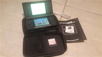 Nintendo DS Lite, charger + 2 games.  Black.  Very good condition.