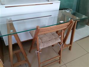 Wooden glass top table with fold up chair